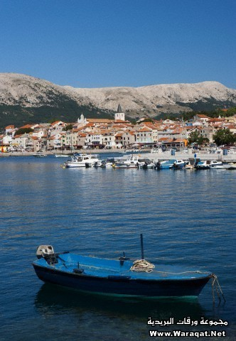Croatia, Boat in adriatic sea at Krk island with Baska town in background