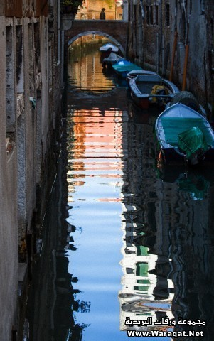 Boats and Reflections in Venice Canals, Italy