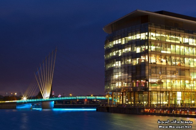 Swing bridge and Media City UK buildings located on the Salford Quays in the city of Salford near Manchester Old Trafford.