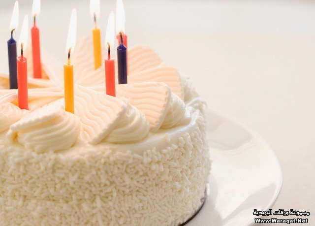 White cake with lit candles
