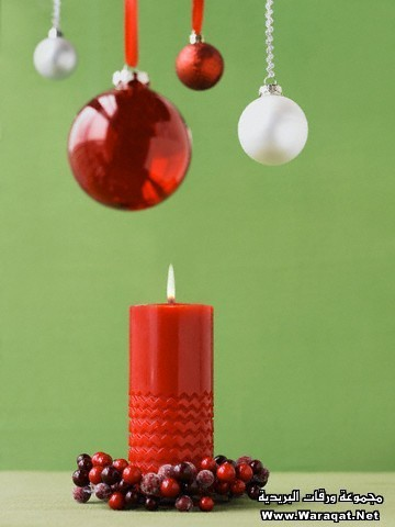Christmas candle and hanging ornaments