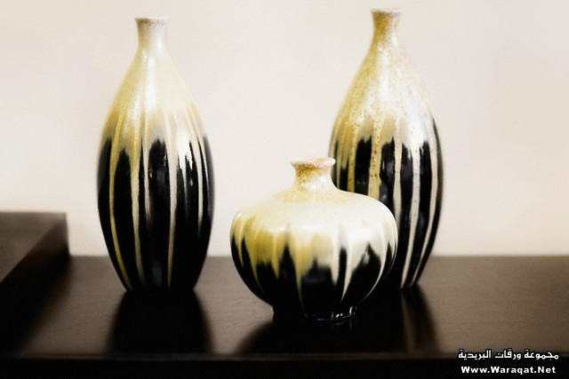 Three vases on a table