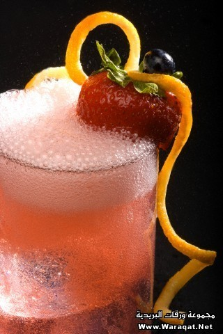 Sparkling pink drink with strawberry orange rind blue berry