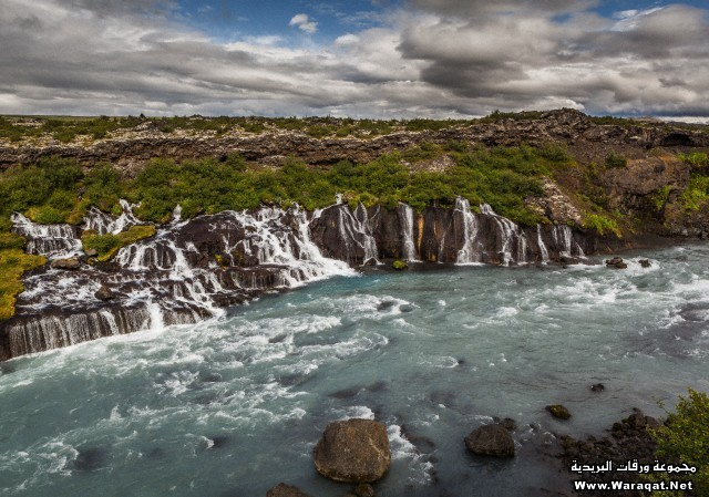 Hraunfossar waterfall flowing into the Hvita River Borgarfjordur, Iceland