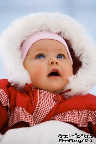 Baby girl in snow suit with mouth open