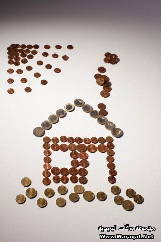 European Union coins arranged into the shape of house and sun