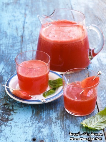 A Summery Watermelon Drink In A Outdoor Picnic Table Setting