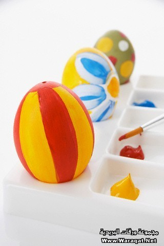 still life of painted easter eggs and paint brush