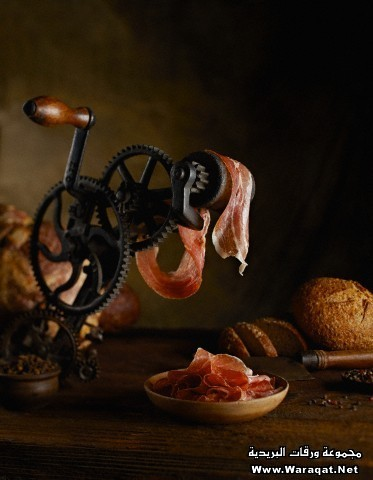Freshly sliced prosciutto with vintage tool