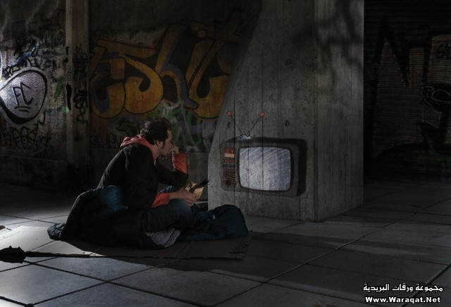 Homeless man watching a graffiti television