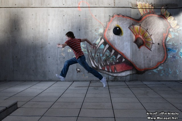 Young man running from a graffiti monster