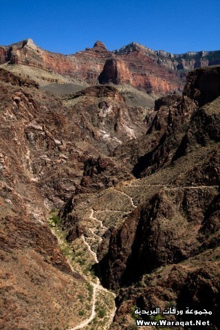 A set of switchbacks ascends a mountainside along the Bright Angel Trail in Grand Canyon National Park, Arizona