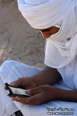 Bedouin Reading Koran in Desert