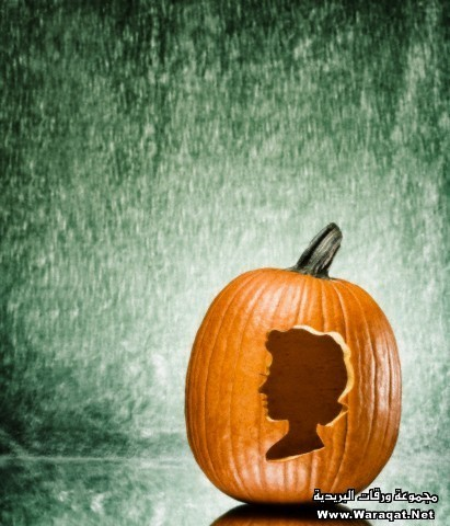Pumpkin with carving of woman's profile