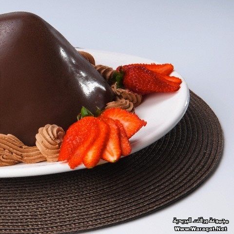 Chocolate dessert served with strawberries