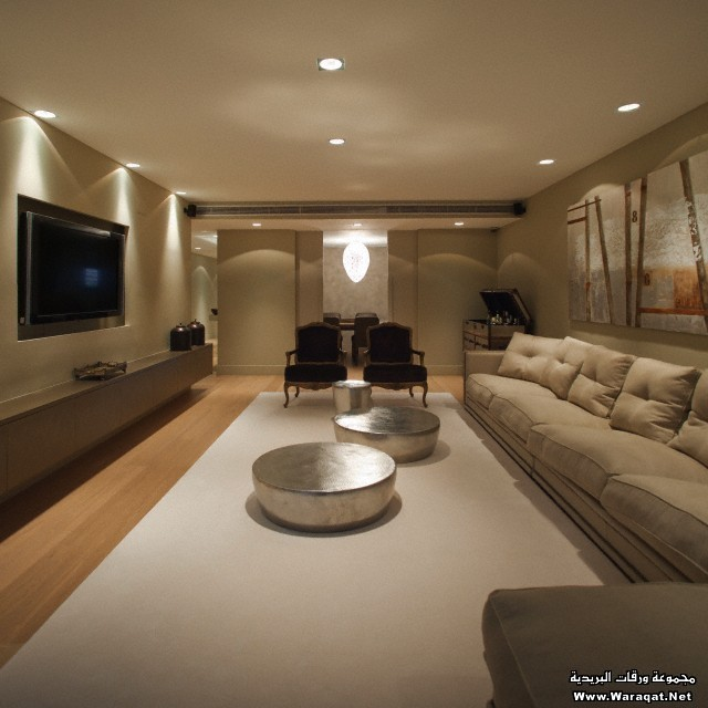 Upholstered seating around silver coffee tables in modern living room, Sarria Flat in Can Rabia st, Barcelona, Spain
